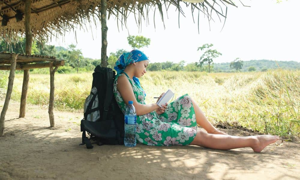 woman on vacation writing diary