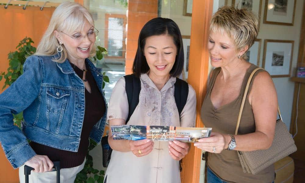 women planning travel trip